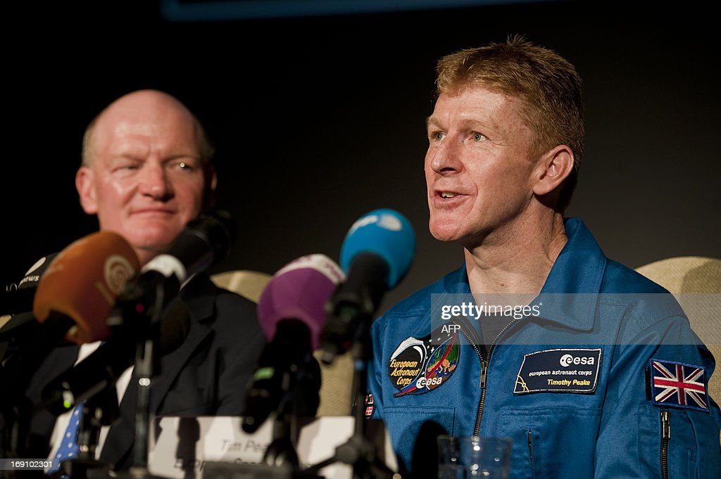 British astronaut Major Tim Peake (R) speaks next to Britain's Science Secretary David Willetts (L) during a press conference at the Science Museum in central London on May 20th 2013, where it was announced Peake will be joining the International Space Station (ISS) in late 2015. A former army helicopter pilot was on May 20 named as the first 'home-grown' British astronaut to head to the International Space Station. Major Tim Peake, 41, will fly out to the ISS in November 2015 as part of a six-man crew, becoming the first Briton ever to travel to space on a British government-funded mission.