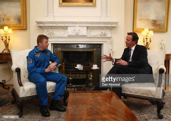 British astronaut Major Tim Peake speaks with British Prime Minister David Cameron in 10 Downing Street on May 20 2013 in London England It was...