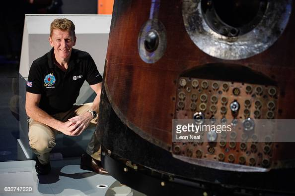 British astronaut Tim Peake poses with the Soyuz TMA19M descent module which he used to return from the International Space Station as it is unveiled...