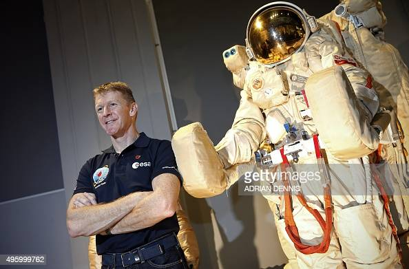 British astronaut Tim Peake stands beside an old space suit on display at the Science Museum in London on November 6 2015 Peake is set to embark on a...