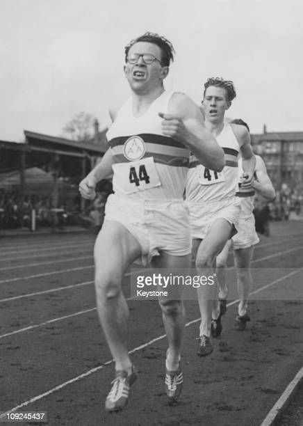 British athlete Chris Brasher runs ahead of Roger Bannister during the first lap of Bannister's recordbreaking sub4minute mile run at Iffley Road...