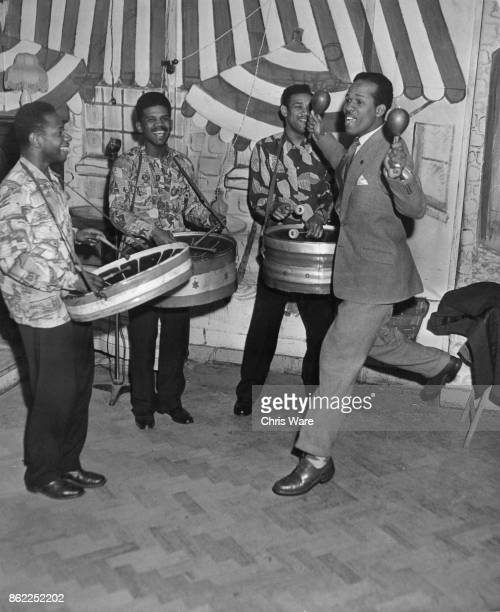 British athlete Emmanuel McDonald Bailey accompanies the Trinidad AllSteel Band on maracas during a rehearsal UK April 1953 Bailey was born in...