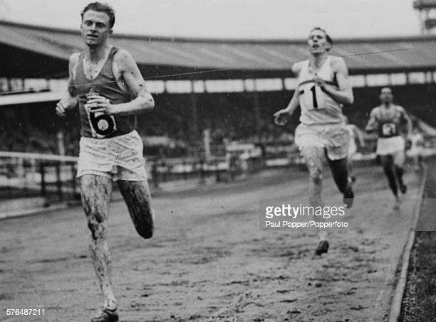 British athlete Roger Bannister is beaten by Czech runner Stanislav Jungwirth during an 880 yard world record race attempt at White City Stadium...