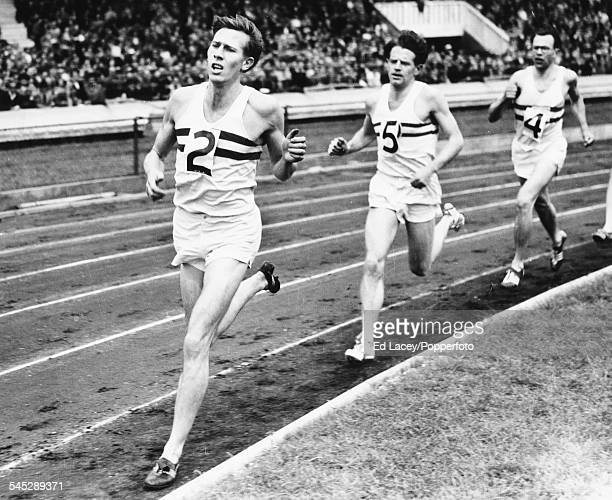 British athlete Roger Bannister leading his pace setters Christopher Chataway and Chris Brasher as he attempts to beat the British 2 mile record in...