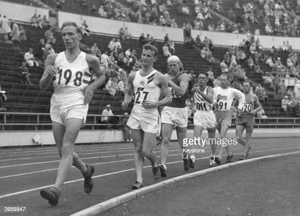 British athlete Roland Hardy leads the field in an Olympic 10000m walk in Helsinki Hardy was eliminated shortly after this picture was taken for 'not...