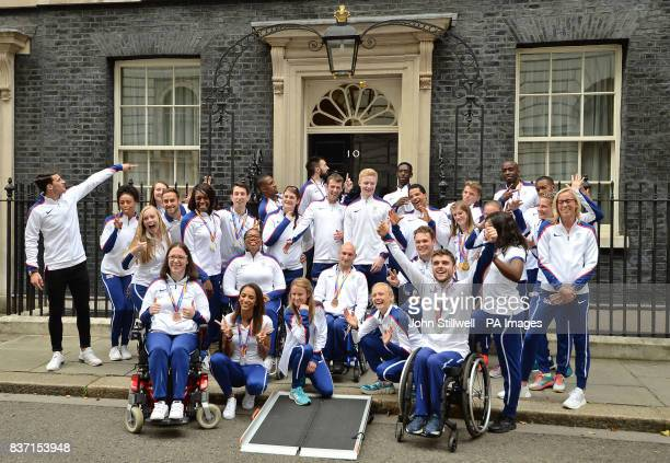 British athletes pose for photos as they leave 10 Downing Street in London after attending a reception hosted by Prime Minister Theresa May for...