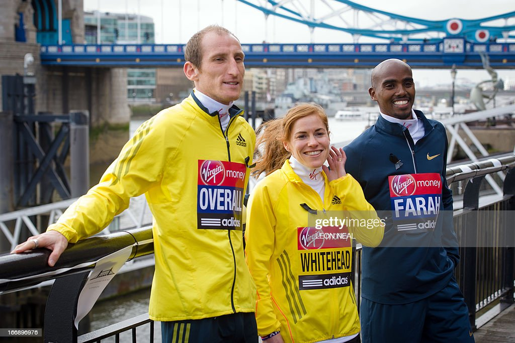 British athletes Scott Overall (L), Amy Whitehead (C) and Olympic double gold medallist Mo Farah pose for photographers in central London on April 18, 2013 during a photo call ahead of the London marathon. The London Marathon will go ahead as planned on April 21, 2013 after security arrangements were reviewed in the wake of the bombings that caused carnage at the Boston Marathon, organisers and police said. AFP PHOTO/LEON NEAL