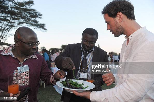 British author and antifood waste campaigner Tristram Stuart offer rejected green beans to delegates on February 19 2013 during the UNEP Governing...