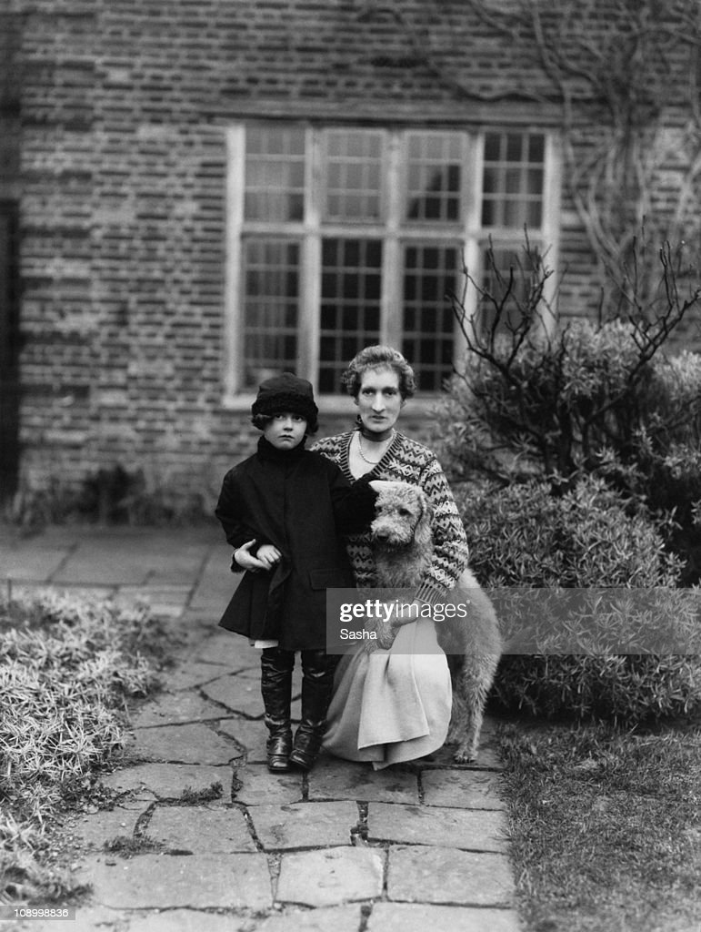 British author and socialite Margot Asquith Countess of Oxford and Asquith with a young girl and a pet dog 1924
