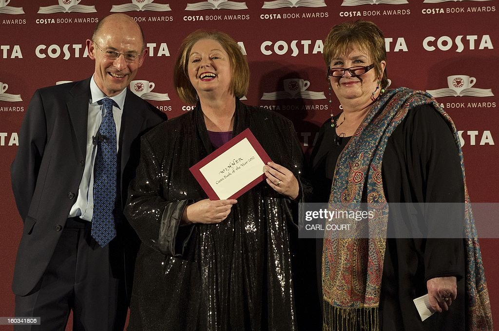 British author Hilary Mantel (C) laughs as she poses with Costa Managing Director, Chris Rogers and journalist Dame Jenni Murray (R) after winning the Costa Book of the Year award at the 2012 Costa Book Awards in London on January 29, 2013. The Costa Book Awards is a literary prize that recognises some of the most enjoyable books of the year by writers based in the UK and Ireland in five categories, with one of the category winners selected as Costa Book of the Year.