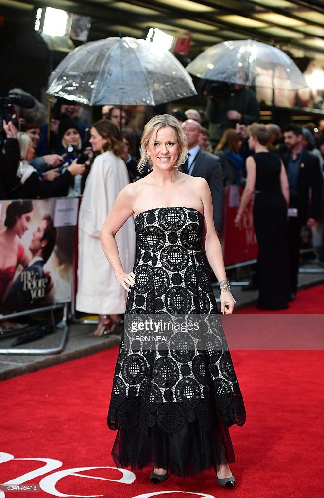 British author Jojo Moyes poses for pictures as she arrives for the European Premiere of the film 'Me Before You' in central London, on May 25, 2016. / AFP / LEON
