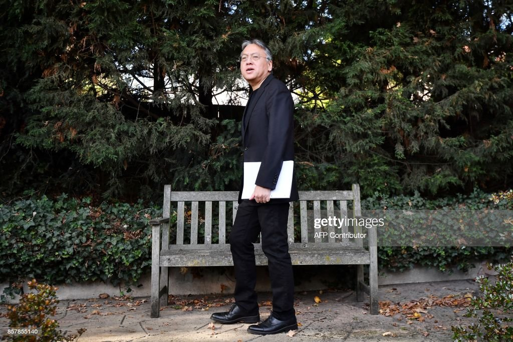 British author Kazuo Ishiguro walks after holding a press conference in London on October 5, 2017 after being awarded the Nobel Prize for Literature. Kazuo Ishiguro, the 62-year-old British writer of Japanese told British media that winning the 2017 Nobel Prize for Literature today was a 'magnificent honour' and 'flabbergastingly flattering'. / AFP PHOTO / Ben STANSALL