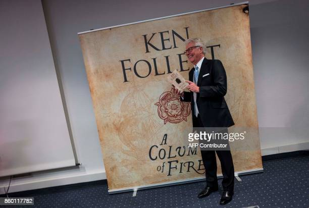 British author Ken Follet poses with the German translation of his novel 'Return to Kingsbridge' prior to a press conference at the Frankfurt Book...