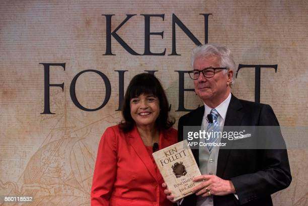 British author Ken Follett and his wife Barbara pose with the German translation of his novel 'Return to Kingsbridge' prior to a press conference at...