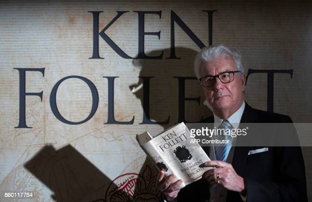 British author Ken Follett poses with the German translation of his novel 'Return to Kingsbridge' prior to a press conference at the Frankfurt Book...