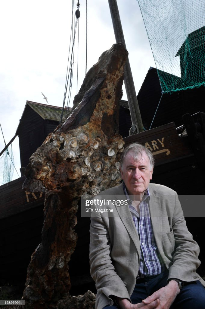 British author of fantasy, horror and science fiction Christopher Priest, during a location shoot on the beach in Hastings, East Sussex, August 25, 2011.