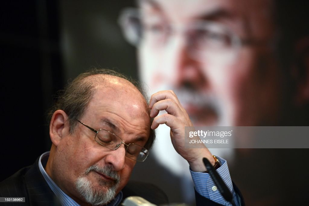 British author Salman Rushdie addresses the press during the presentation of his book 'Joseph Anton' on October 1, 2012 in Berlin. As violent protests over a US-made film rock the Muslim world, Salman Rushdie publishes his account of the decade he spent in hiding while under a fatwa for his book 'The Satanic Verses'. AFP PHOTO / JOHANNES EISELE