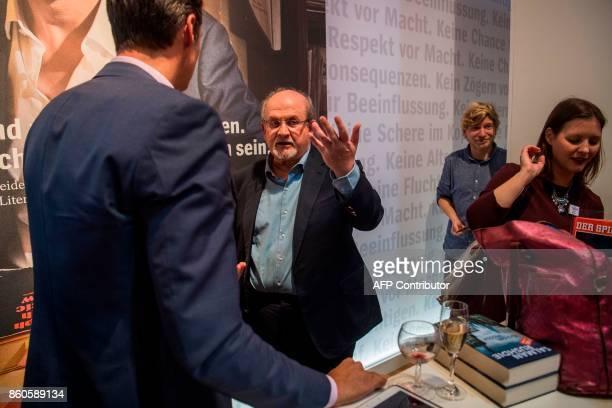 British author Salman Rushdie chats with chief editor of German weekly Der Spiegel Klaus Brinkbaeumer at the Frankfurt Book Fair 2017 in Frankfurt am...