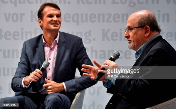 British author Salman Rushdie discusses his latest novel 'Golden House' with chief editor of German weekly Der Spiegel Klaus Brinkbaeumer at the...