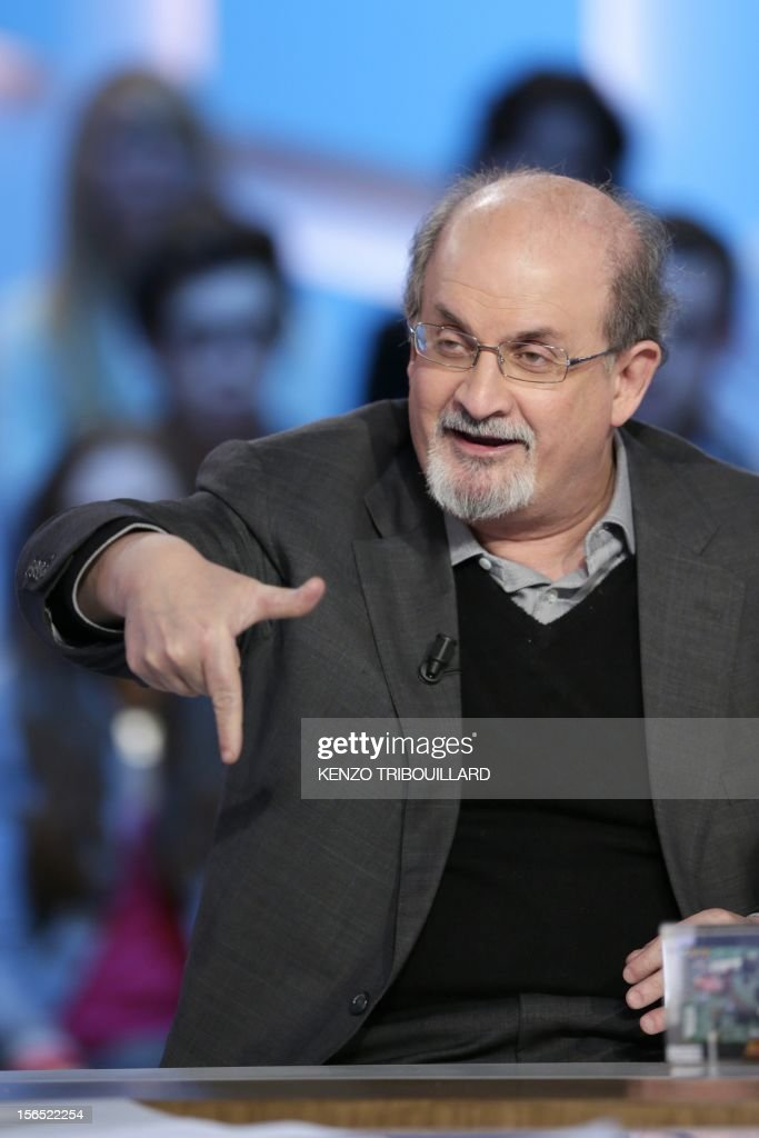 British author Salman Rushdie takes part in the TV show 'Le grand journal' on a set of French TV Canal+, on November 16, 2012 in Paris.