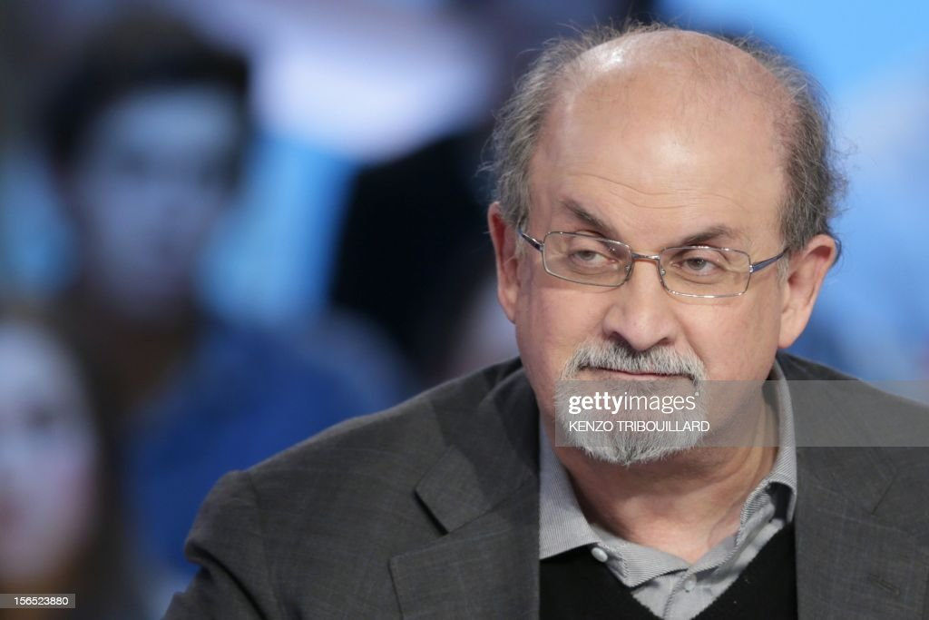 British author Salman Rushdie takes part in the TV show 'Le grand journal' on a set of French TV Canal+, on November 16, 2012 in Paris. AFP PHOTO/KENZO TRIBOUILLARD