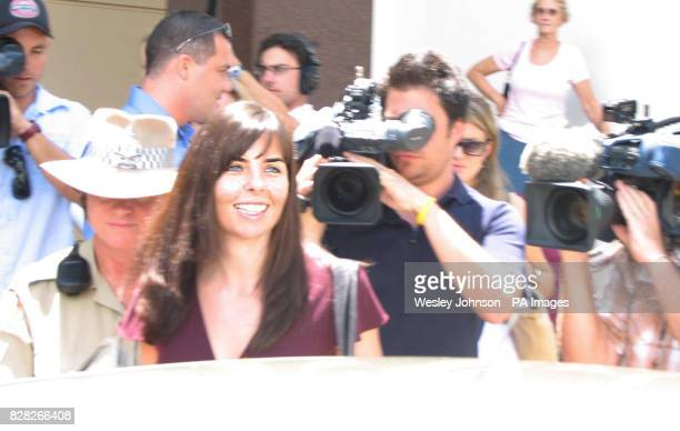 British backpacker Peter Falconio's girlfriend Joanne Lees smiles as she leaves Northern Territory Supreme Court in Darwin Thursday December 15 after...