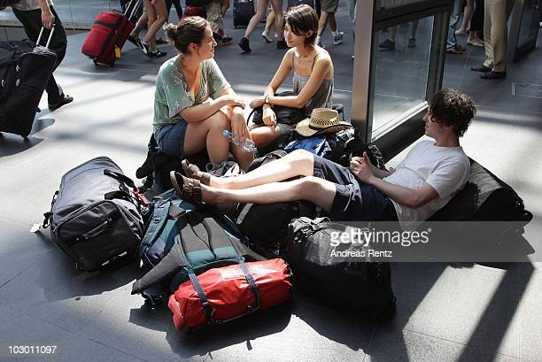 British backpacker rest prior to their next trip at Hauptbahnhof train station on July 19 2010 in Berlin Germany Millions of youth people taking a...