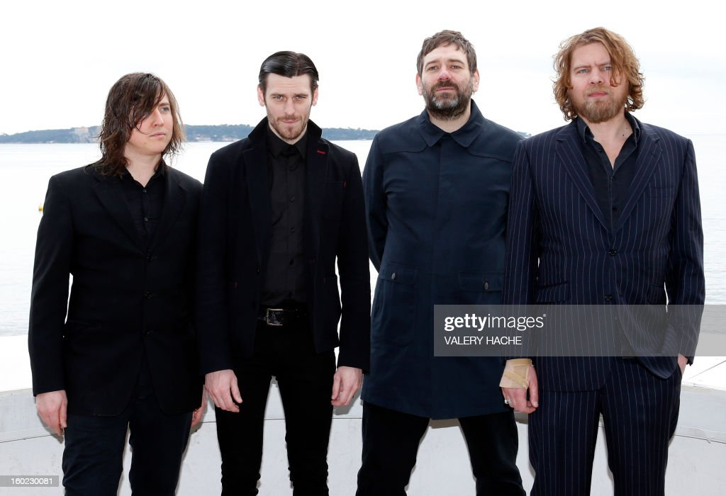 British band Archive members pose during a photocall as part of the music world's largest annual trade fair, Midem, on January 28, 2013 in Cannes, southeastern France. The Midem music trade show will bring 7,000 of the global industry's biggest players together on the French Riviera for four days. AFP PHOTO / VALERY HACHE