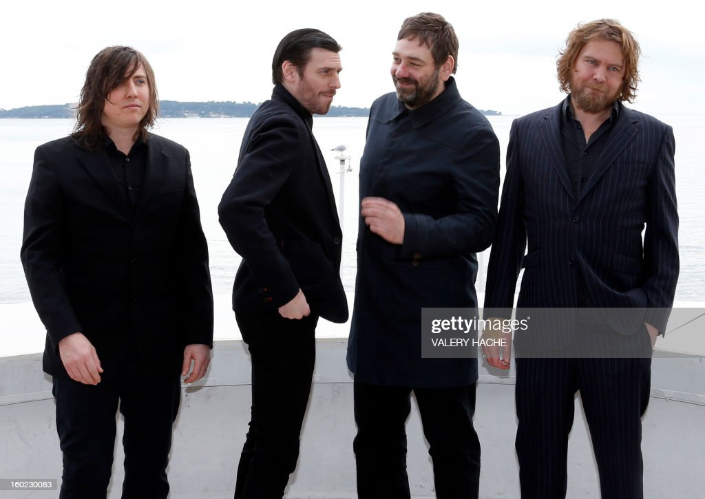 British band Archive members pose during a photocall as part of the music world's largest annual trade fair, Midem, on January 28, 2013 in Cannes, southeastern France. The Midem music trade show will bring 7,000 of the global industry's biggest players together on the French Riviera for four days.