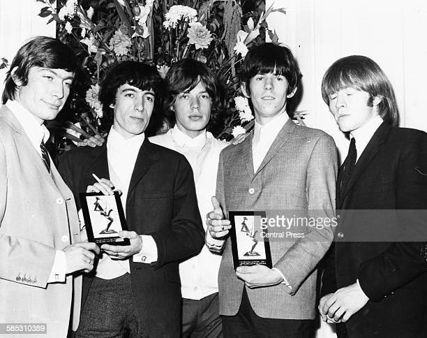 British band 'The Rolling Stones' Charlie Watts Bill Wyman Mick Jagger Keith Richards and Brian Jones holding their awards for 'Best Group in...