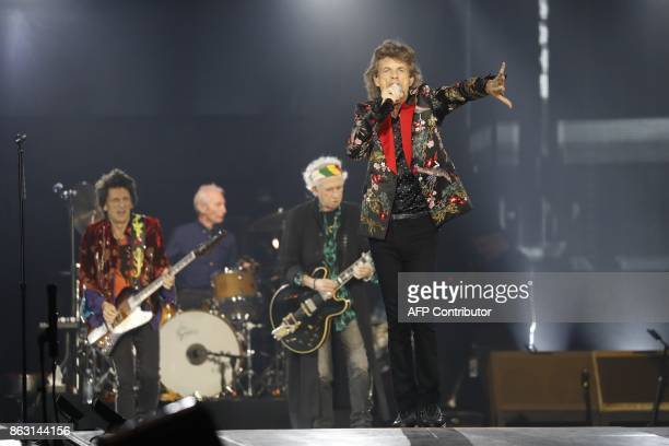 TOPSHOT British band the Rolling Stones singer Mick Jagger guitarist Keith Richards drumer Charlie Watts and guitarist Ron Wood perform with the band...