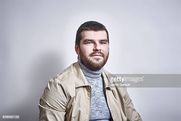 British bearded male looking to camera