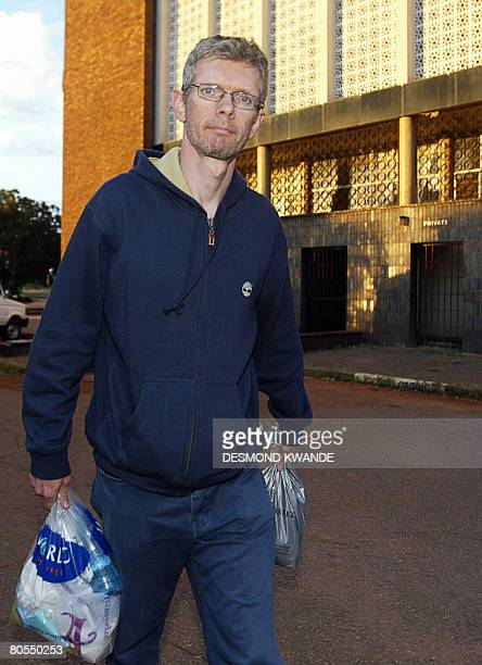 British Beavan Stevens one of the two journalist who were arrested in Zimbabwe leaves the Magistrate court in Harare on April 7 2008Charged for...