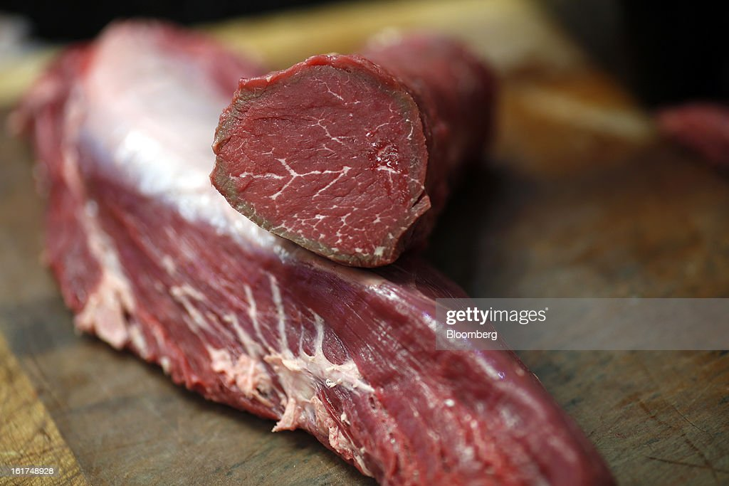 A British beef joint sits on a wooden chopping block at M.Moen & Sons butcher's shop in the Clapham district of London, U.K., on Friday, Feb. 15, 2013. While there's no evidence yet that consumer beef demand has slowed in the U.K., customers probably will spend more on higher quality cuts at meat counters or buy from independent butchers, Nick Allen, the executive director of the Agriculture & Horticulture Development Board's beef and lamb unit, known as Eblex, said. Photographer: Simon Dawson/Bloomberg via Getty Images