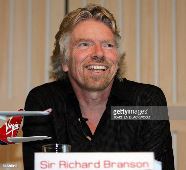 British billionaire Sir Richard Branson is all smiles as he promotes the maiden flight of his flagship airline Virgin Atlantic from London to...