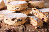 British biscuits: Welsh cakes with raisins and powdered sugar close-up on the table. horizontal