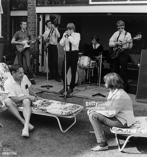 British blues band The Yardbirds perform for screenwriter Lord Ted Willis in his garden in Chislehurst Kent 1964 L to R Lord Ted Willis Eric Clapton...