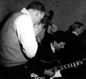 Photo of Alexis KORNER and Andy HOOGENBOOM and Cyril DAVIES and Keith SCOTT Cyril Davies and Alexis Korner performing live at the Ealing Club with...