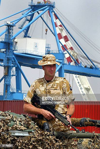 British bombadier Bates of the 17th batery of the Royal Artillery 26th regiment stands guard in a military area at Umm Qasr's port 80 Km from Basra...