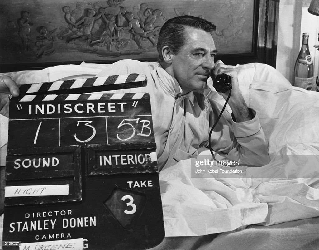 British born actor Cary Grant (1904 - 1986), born Archibald Leach, on the set of the film 'Indiscreet'. Directed by Stanley Donen, the film also starred Ingrid Bergman and was filmed in London.