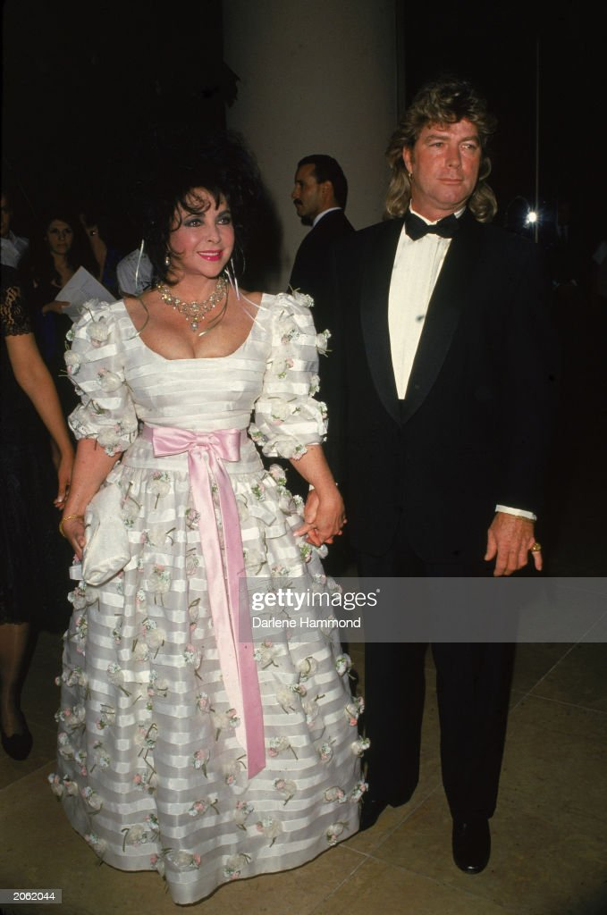 British born actor <a gi-track='captionPersonalityLinkClicked' href=/galleries/search?phrase=Elizabeth+Taylor&family=editorial&specificpeople=69995 ng-click='$event.stopPropagation()'>Elizabeth Taylor</a> and her eighth husband <a gi-track='captionPersonalityLinkClicked' href=/galleries/search?phrase=Larry+Fortensky&family=editorial&specificpeople=893609 ng-click='$event.stopPropagation()'>Larry Fortensky</a> arrive at a formal event, c. 1993.