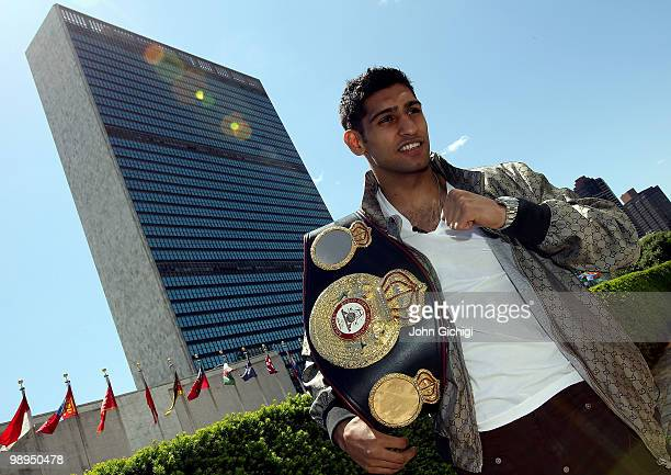 British boxer Amir Khan poses with the WBA World light welterweight championship belt in front of the United Nations Headquarters on May 10 2010 in...