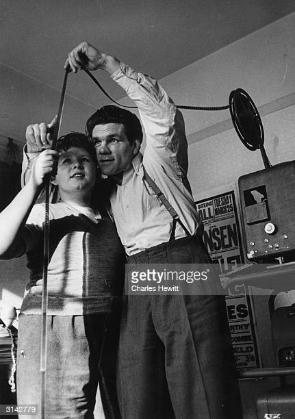 British boxer and former world lightheavyweight champion Freddie Mills examines film footage of one of his fights Original Publication Picture Post...