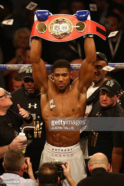 British boxer Anthony Joshua celebrates beating US boxer Charles Martin following their IBF World Heavyweight title boxing match at the O2 arena in...