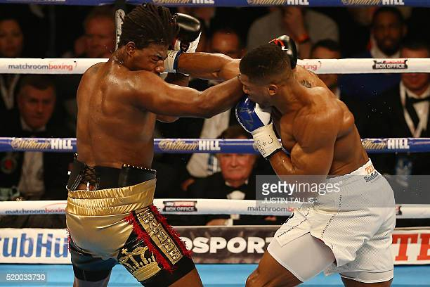 British boxer Anthony Joshua delivers a knock out punch to US boxer Charles Martin during their IBF World Heavyweight title boxing match at the O2...