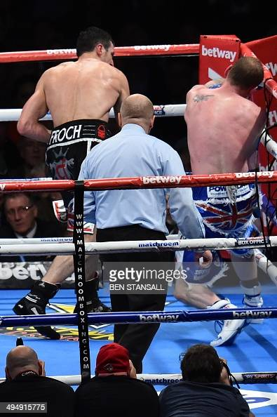 British boxer Carl Froch delivers the knock out right hand punch as British boxer George Groves goes down during their WBA and IBF supermiddleweight...