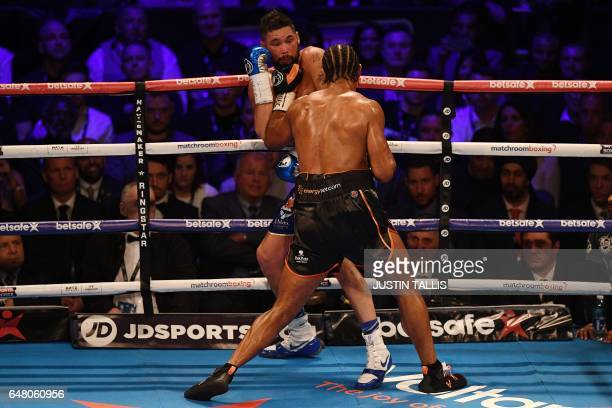 British boxer David Haye battles compatriot Tony Bellew against the ropes during their heavyweight boxing match at the O2 Arena in London on March 4...