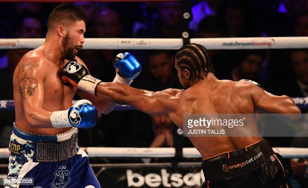 British boxer David Haye extends a left against compatriot Tony Bellew during their heavyweight boxing match at the O2 Arena in London on March 4...