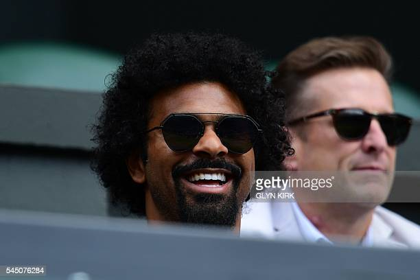 British boxer David Haye sits on centre court to watch US player Serena Williams play against Russia's Anastasia Pavlyuchenkova during their women's...