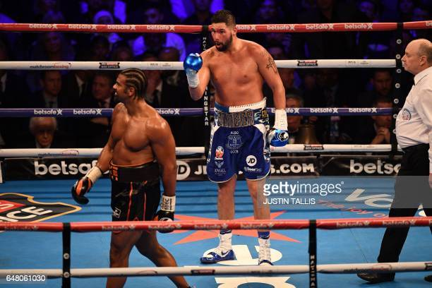 British boxer David Haye walks back to his corner after the round has ended as compatriot Tony Bellew gestures during their heavyweight boxing match...